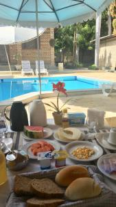 The swimming pool at or near Chalé Executivo Apart Hotel