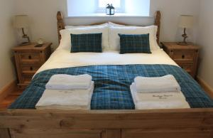 A bed or beds in a room at The Annex at Borlum House