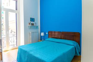 A bed or beds in a room at B&B Le Marinelle