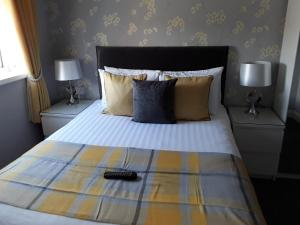 A bed or beds in a room at Manchester House
