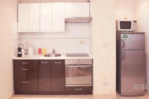 A kitchen or kitchenette at Apartament 201 w Hotelu DIVA