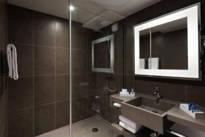 Ванная комната в Novotel Paris Charles de Gaulle Airport