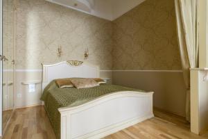 Кровать или кровати в номере Life Inn Apartments