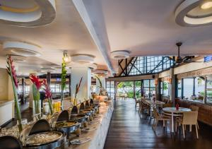 A restaurant or other place to eat at Club Paradise Resort Palawan