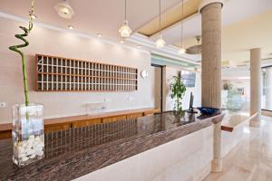 The lobby or reception area at azuLine Hotel - Apartamento Rosamar