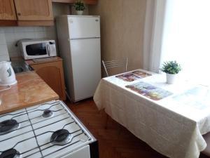 Кухня или мини-кухня в Apartment Rental