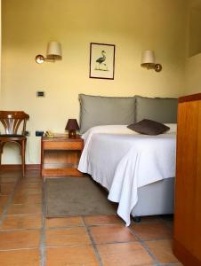 A bed or beds in a room at Relais San Rocco