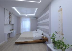 A bed or beds in a room at Le suite del nostromo
