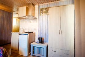 A kitchen or kitchenette at Freedom Square Apart Hotel