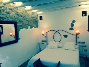 Cama o camas de una habitación en Hotel Galena Mas Comangau