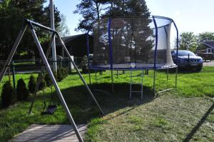 Children's play area at Apartamentai Trys pušys
