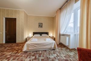 Кровать или кровати в номере Челси Отель