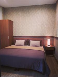 Ein Bett oder Betten in einem Zimmer der Unterkunft Ning Homestay