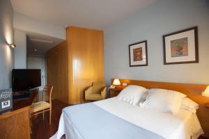 Кровать или кровати в номере Nuria