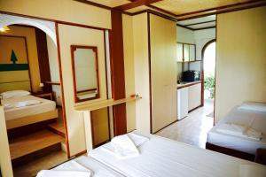 Ένα ή περισσότερα κρεβάτια σε δωμάτιο στο Damnoni Paradise