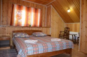 Кровать или кровати в номере Шале Хаус
