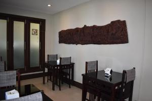 A restaurant or other place to eat at VKS Hotel