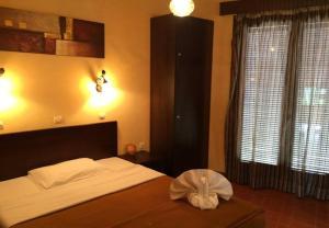 Ένα ή περισσότερα κρεβάτια σε δωμάτιο στο Green Hotel
