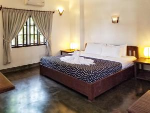 A bed or beds in a room at Uncle Sam Villa