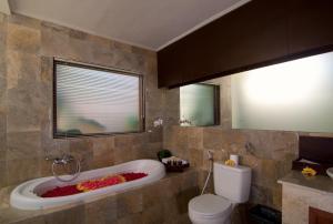 A bathroom at The Awan Villas