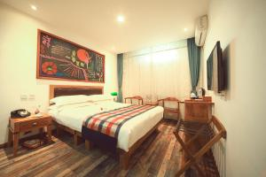 Ein Bett oder Betten in einem Zimmer der Unterkunft Nostalgia Hotel Beijing Confucius Temple