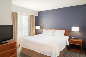 A bed or beds in a room at Residence Inn New Bedford Dartmouth