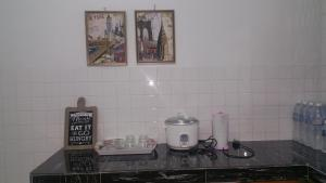 A kitchen or kitchenette at GuestHouse Taman Megah, Lot 19
