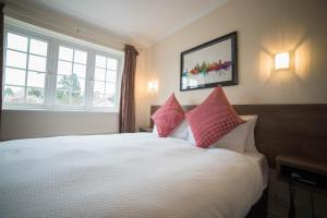 A bed or beds in a room at Red Mullions Guest House