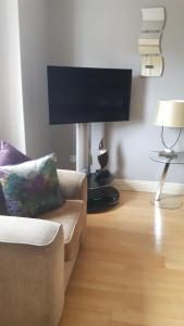 A television and/or entertainment center at Almara House