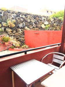A balcony or terrace at Pensión Los Volcanes