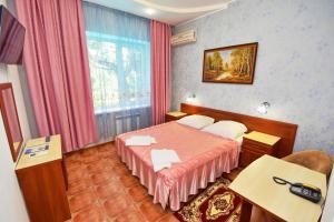 Кровать или кровати в номере Malahit