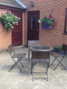 A patio or other outdoor area at The Farmhouse B&B
