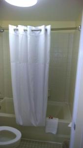 A bathroom at Days Inn & Suites by Wyndham Davenport
