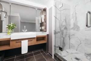 A bathroom at Cordis, Auckland by Langham Hospitality Group
