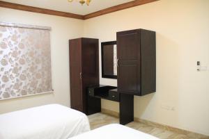 Cama ou camas em um quarto em Ahla Makan