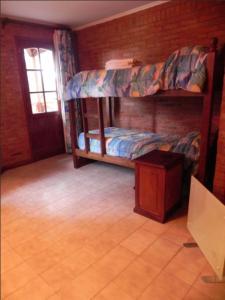 Una cama o camas cuchetas en una habitación  de Vacances Dorado