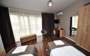 Ein Sitzbereich in der Unterkunft Boho Tiflis Hotel