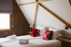 A bed or beds in a room at B&B VEADO