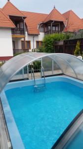 The swimming pool at or close to Apartman Klaudia