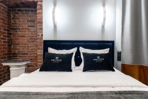 Кровать или кровати в номере Бутик Отель Мельцер