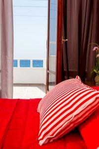 Vuode tai vuoteita majoituspaikassa Irini's Rooms Fteoura