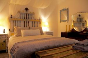 A bed or beds in a room at Casa Esti