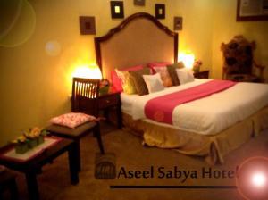 Cama ou camas em um quarto em Aseel Hotel Apartment