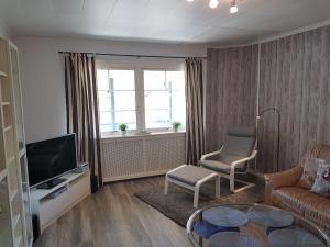 En tv och/eller ett underhållningssystem på Villa Majringen