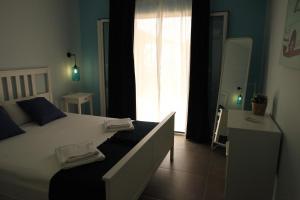 Letto o letti in una camera di Agnantio Apartments
