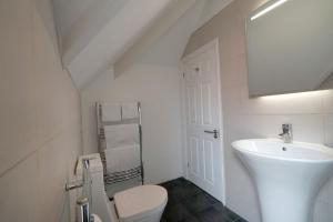 A bathroom at One Helena Road Serviced Apartments