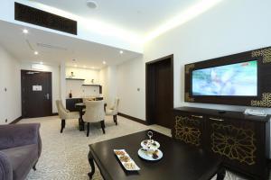 Телевизор и/или развлекательный центр в thelocal Hotels Grozny