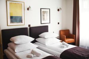 A bed or beds in a room at Hotel Eden