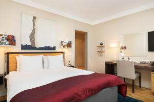 A bed or beds in a room at ProfilHotels Riddargatan