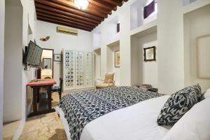 Vuode tai vuoteita majoituspaikassa XVA Art Hotel